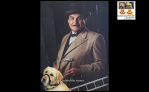 Me guide dog Fletcher in front of a poster of Hercule Poirot also know as David Suchet the actor. You can just see my golden head against the dark poster. Hercule has a moustashe, bowler hat and bow tie. @pawsatthekerb