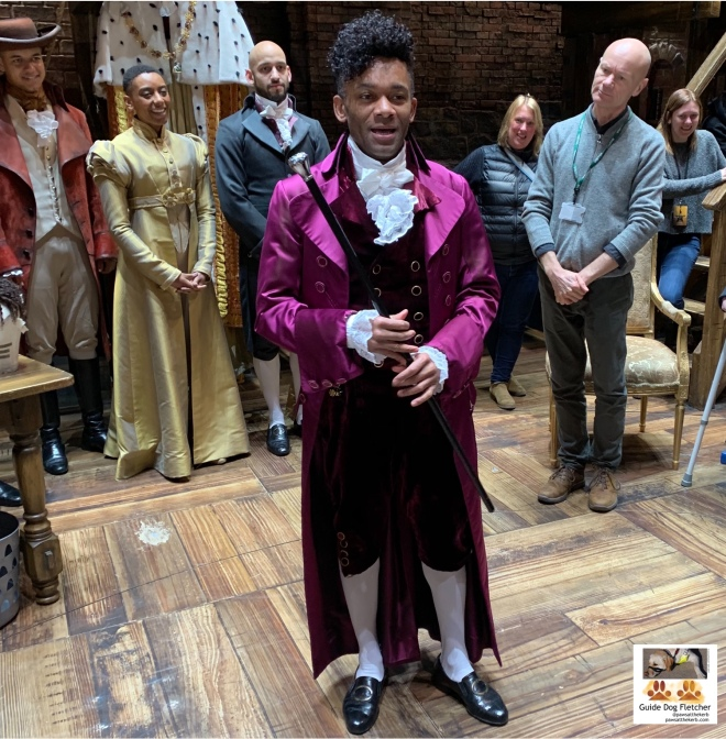 Hamilton audio described performance touch touch with some of the cast and Vocal Eyes team. Jefferson character is in centre describing his purple outfit. More details in next photo.@pawsatthekerb.